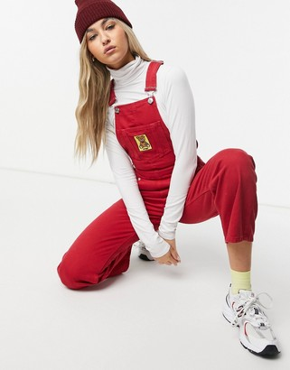 Minga London relaxed denim overalls with bear patch in red