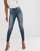 Asos DESIGN Lisbon mid rise skinny jeans in extreme dark stonewash with knee rips