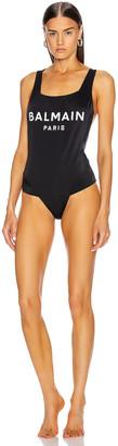 Balmain Logo Swimsuit in Black | FWRD