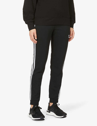 adidas Logo-print mid-rise cotton- and recycled-polyester blend jogging bottoms