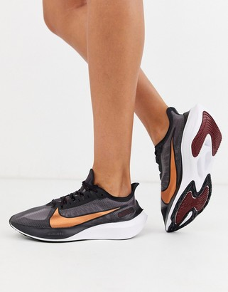 Nike Running air zoom gravity sneakers in black with metallic swoosh