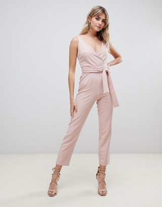 ASOS DESIGN wrap front jumpsuit with peg leg and self belt in blush
