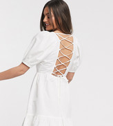 Asos DESIGN Petite tiered mini dress with puff sleeves and open back in white