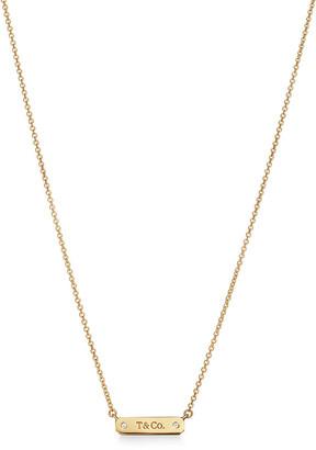 "Tiffany & Co. micro bar pendant in 18k gold with diamonds, 16-18""."