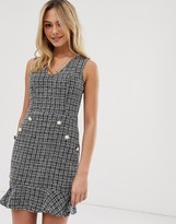 Parisian tweed dress with fluted hem and pearl effect buttons