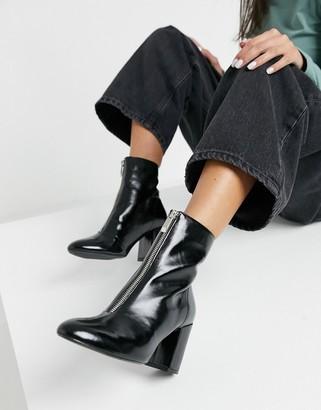 Bershka zip front heeled boot in black