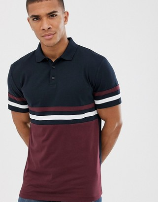 ASOS DESIGN polo shirt with contrast body and sleeve panels in navy