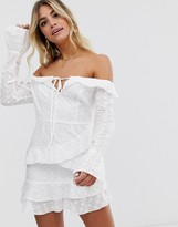 In The Style x Dani Dyer off shoulder lace ruffle mini dress with asymmetric hem in white