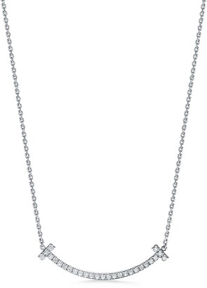 Tiffany & Co. T medium smile pendant in 18k white gold with diamonds