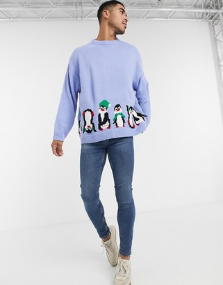 ASOS DESIGN oversized christmas sweater with front and back penguin design