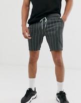 Asos Design DESIGN jersey skinny shorts in pinstripe