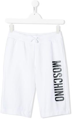 Moschino Kids TEEN logo printed track shorts