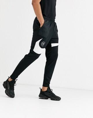 Nike F.C. swoosh joggers in black