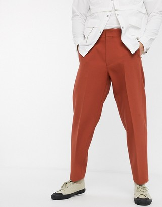 ASOS DESIGN oversized tapered smart pants in rust