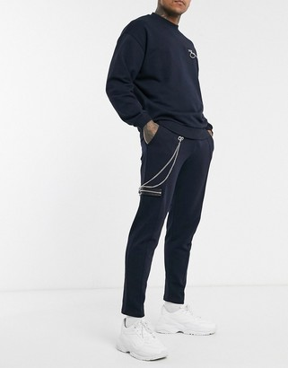 Asos Design DESIGN co-ord super skinny joggers with zip pocket & chain details in navy