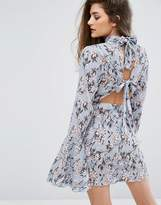 Missguided Floral Plisse Frill Sleeve Dress With Open Back