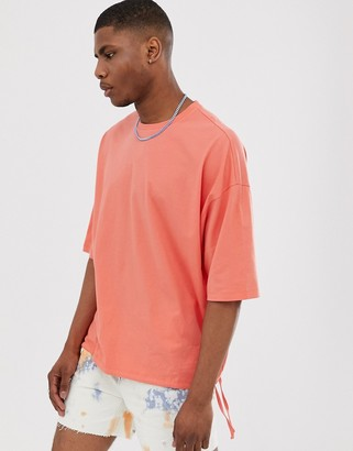 Asos Design DESIGN oversized t-shirt with drawstring hem in orange