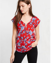 Express red floral print zip front blouse