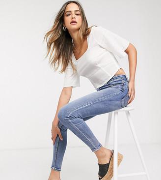 Stradivarius Tall super high waist skinny jeans in light blue wash
