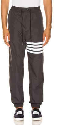 Thom Browne Track Pants in Charcoal | FWRD