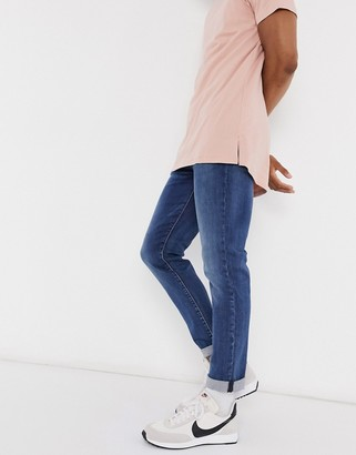 Levi's 512 slim tapered low rise jeans in revolt mid wash