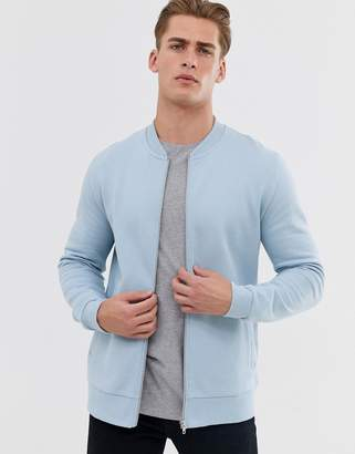 Asos Design DESIGN jersey bomber jacket in light blue