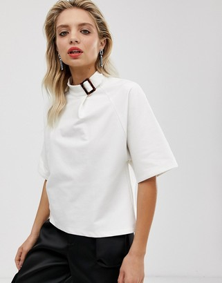 Asos high neck t-shirt with buckle detail
