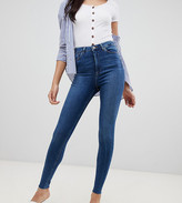 Asos Tall DESIGN Tall Ridley high waisted skinny jeans in dark stone wash with raw hem detail