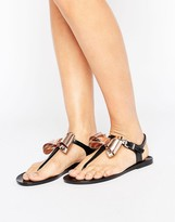 Ted Baker Ainda Black and Gold Bow Toe Post Sandals