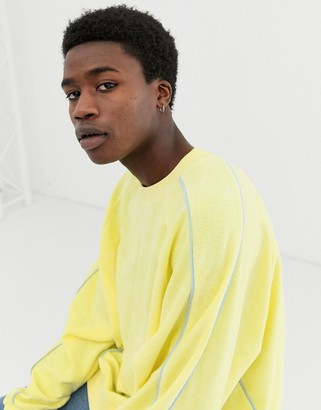 Asos Design DESIGN oversized sweatshirt in towelling with piping in yellow