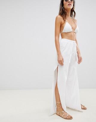ASOS DESIGN beach pants in linen with side split & tortoiseshell buttons