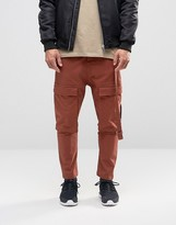 Asos Drop Crotch Cropped Pants With Cargo Pockets In Rust
