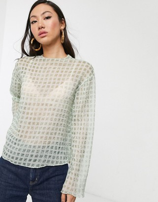 Glamorous relaxed top in sheer mini check