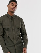 Asos Design DESIGN nylon overshirt with double pockets in khaki with buckles