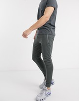 Asos Design DESIGN organic super skinny joggers in washed black with silver zip pockets