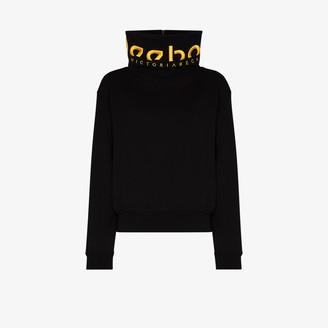 Reebok x Victoria Beckham Embroidered Funnel Neck Logo Sweater