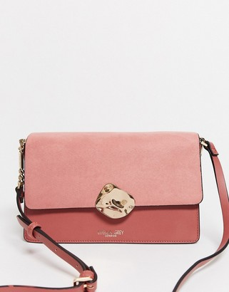 Luella Grey cross body bag in rose with contrast suede front flap and molten gold buckle