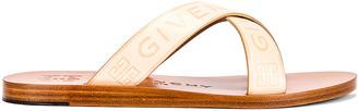 Givenchy Strap Criss Cross Flat Sandals in Desert | FWRD