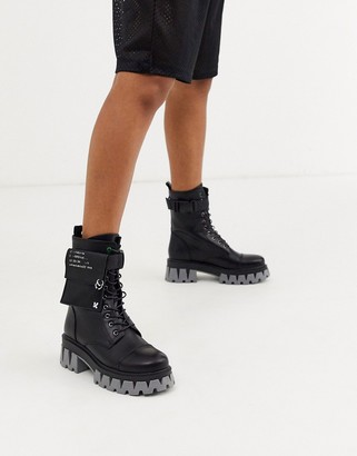 Koi Footwear vegan Banshee military lace up boots with extreme grey sole in black