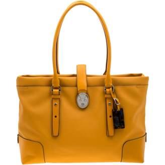Tumi Yellow Leather Handbags