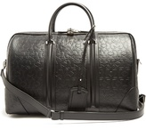 Givenchy Logo And Star-debossed Leather Holdall
