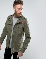 Pretty Green Jayton M65 Jacket Badges And Logo In Khaki Green