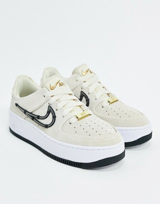 Nike Force 1 Sage trainers with metal stitched in swoosh