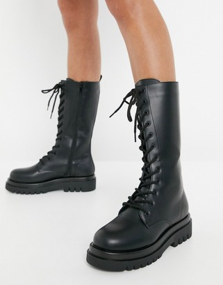 Truffle Collection lace up knee high chunky boots in black