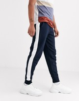 Asos Design DESIGN tapered jogger with side stripe in navy