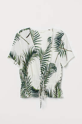 H&M V-neck buttoned blouse