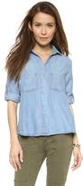 uncategorized  Who made Chrissy Teigens blue denim shirt?