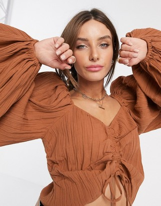 ASOS DESIGN long sleeve top with ruched detail in natural crinkle