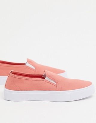 ASOS DESIGN Dotty slip on plimsolls in peach