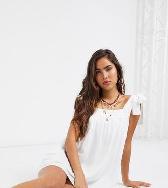 Esmée Esmee Exclusive swing mini beach dress with tie detail in white